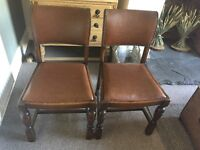 Two antique leather studded dark brown wooden dining kitchen study chairs