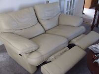 reclining two seat sofa. cream leather.