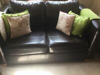 Chocolate brown sofa and tub chair