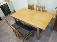 Nearly new extendable table and 4 half leather chairs