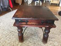 Solid wood side table with iron detail