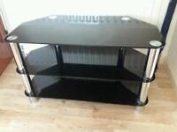 Black glass and chrome TV unit. in excellent condition.