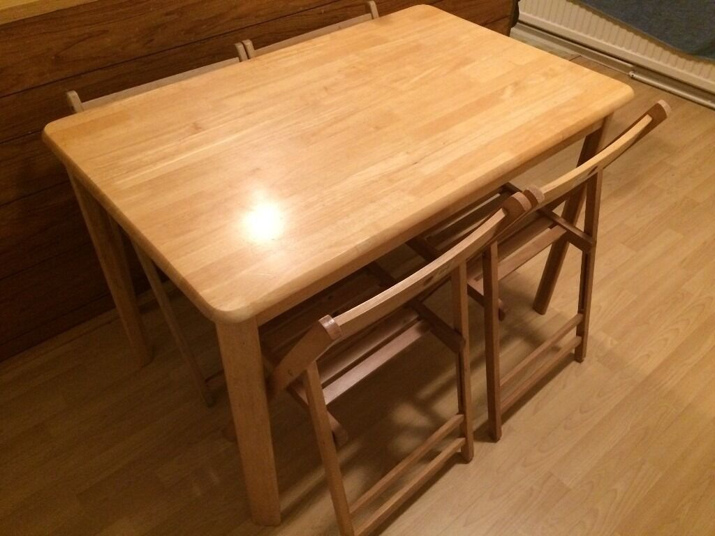 Dining table and 4 chairsin Littleover, DerbyshireGumtree - Dining table and four foldable chairs (two sets of two, not exactly the same) Sturdy table, used but good condition. Selling due to leaving the UK. Please see my other ads. Txt or email, no calls please