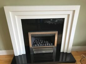 Modern white wood fireplace and black granite hearth, including 18 in gas fire, excellent condition.