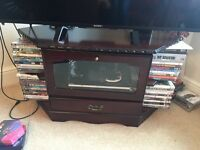 Corner TV cabinet with DVD storage.