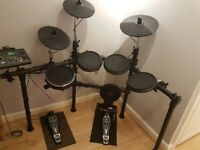 Electric Drum Kit 450+ with Seat Drum Sticks and Headphones - complete set in immaculate condition.