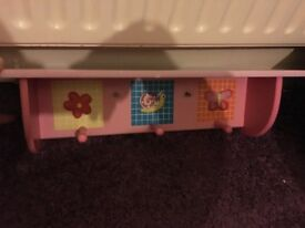 Girls shelf with hooks