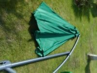 very large green parasol with base