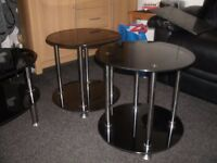 Two smoke glass small round tables