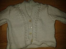 hand knitted brand new babies cardigan