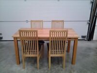 Ex display choc faux and wood. Dining table and four chairs, can deliver.