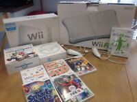 Wii Bundle, includes console, 2 controllers, balance board, 2 steering wheels, and more...