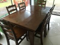 Solid Oak dinning table expandable to 8 chairs