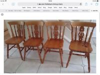 Pine round dining table, 1 metre in diameter and four fiddle back chairs