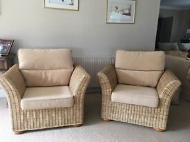 Twin pair of lovely wicker, rattan conservatory chairs with beige cushions