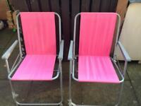 Two garden folding chairs in pink