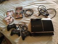 1st edition Playstation 3, 3 controllers, 4 games. Complete cables!