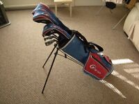 Junior size graphite shaft golf clubs Excellent cond. Bag, golf head covers, hood & golf glove