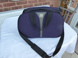 Tripp carry on bag
