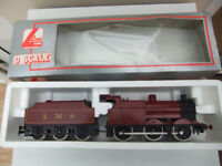 o gauge 0-6-0 Locomotive with tender in LMS maroon livery. Excellent. Boxed