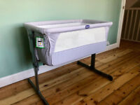 Chicco Next2Me crib/cot virtually unused in original packing including 6 new sheets.