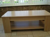 Coffee Table in light oak with rising top 105 x 50 x 40 hi