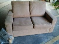 very small sofa in good condition can deliver