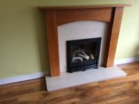 Marble fireplace and wood mantel piece