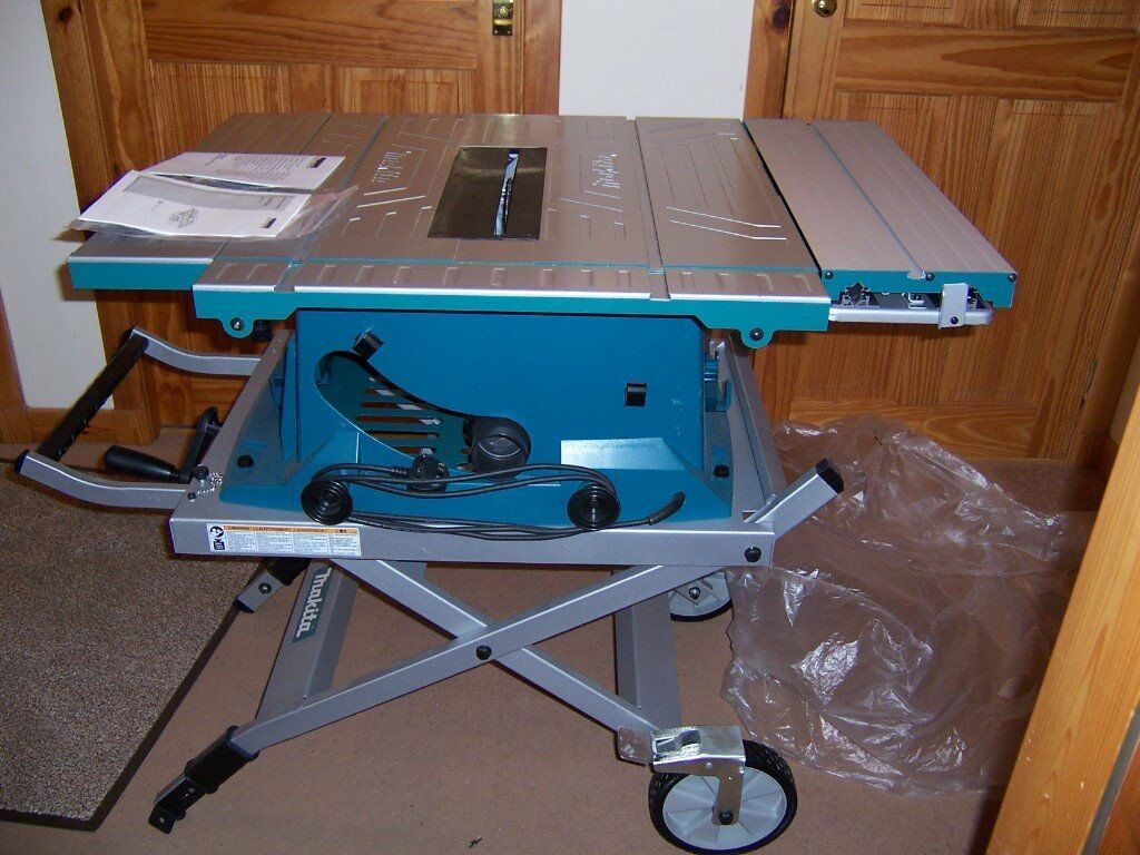 MAKITA MLT100 TABLE SAW WITH GAURD NEW, NEW complet with hight adjustable  stand £395