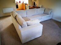 Cream L-shaped sofa for quick sale