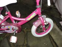 raleigh molly bike with stabilisers 12 incch wheels