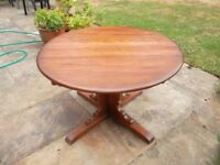 Ercol 1970's vintage solid wood round/oval extending dining table