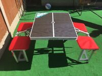 Folding camping table with stools attached, including 2 sets of seat pads