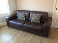Brown leather suite, arm chair and storage puffet