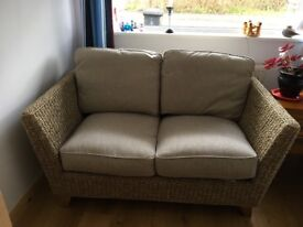 Two seater rattan sofa. Hardly used.