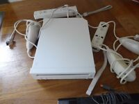 Wii box - 2 controllers and 2 nanchucks and 9 games