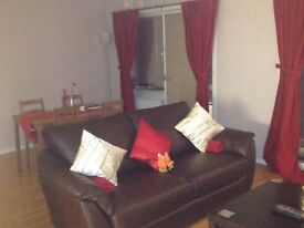 3-seat dark brown leather sofa bed - £450