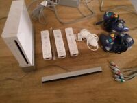 Nintendo Wii console with 3 wiimotes, 1 nunchuk, 2 GC controllers and many games