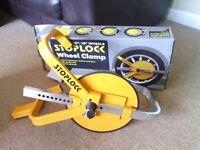 Stoplock wheel clamp wheelclamp. New. caravan car trailer