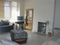 "Spacious three bedroom house with secluded 60"" rear garden"
