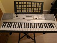 Electric Yamaha keyboard and stand