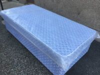 TWO NEW SINGLE DIVAN BEDS AND NEW MATTRESSES -- CAN DELIVER LOCALLY --