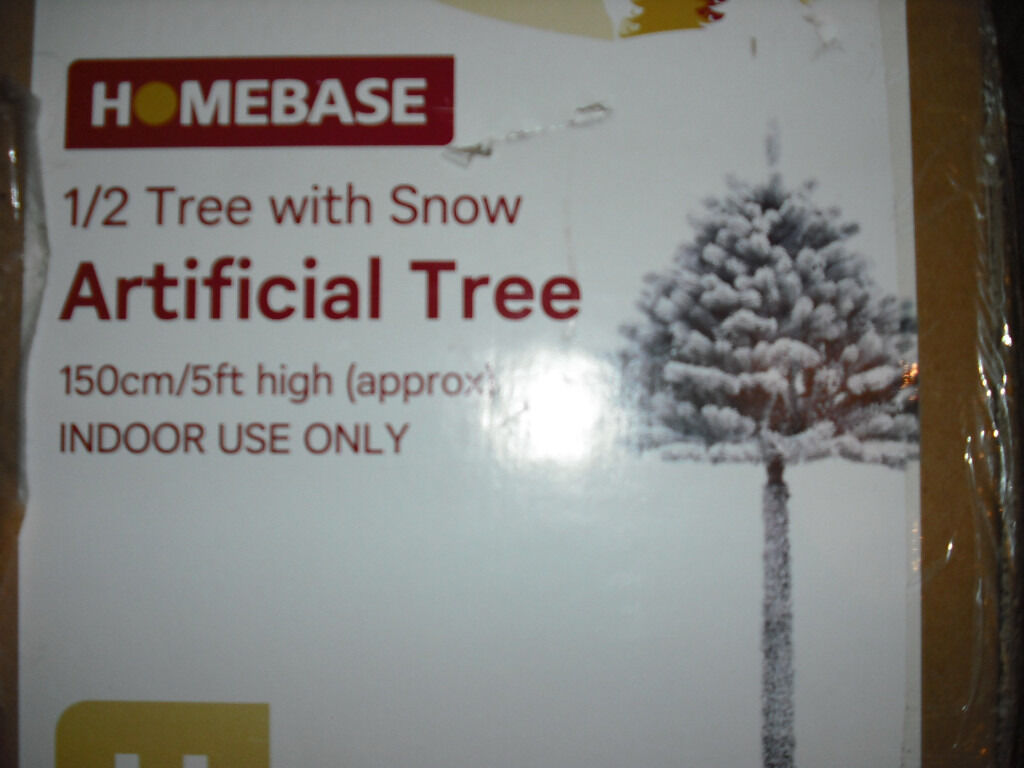 5ft 1/2 Christmas tree, thick branches, sprayed with fake snow, read description