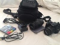 Canon Camera. Near to new, extra lense, bag, charger and more.