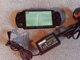 SONY PSP WITH POWER SUPPLY AND FOOTBALL GAME