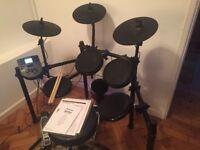Alesis Nitro electronic drum kit.