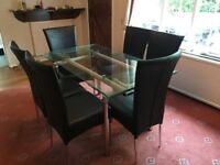Glass Extendable Dining Table with Chrome legs. (NO CHAIRS)