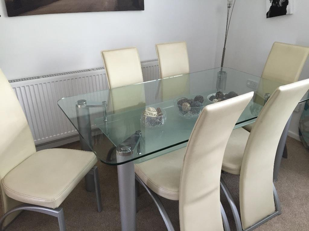 Glass dining room table and 6 chairs in cwmbran for Dining room tables on gumtree