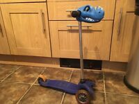 Blue microscooter with seat attachment , dinosaur head and pull along lead