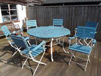 Outdoor table and six chairs. Requires some renovation of table top.